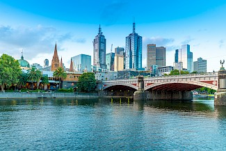 Melbourne City skyline on river with bridge