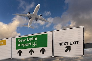 Sign to New Delhi airport with plane